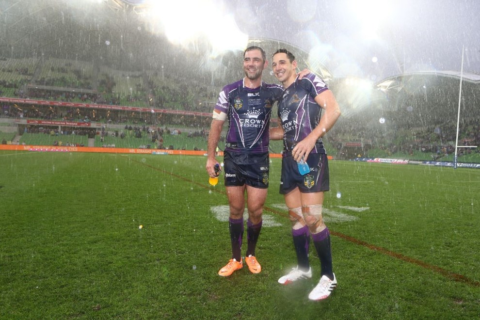 Digital Image by Brett Crockford © nrlphotos.com :   Cameron Smith celebrates the Storm playing record and Billy Slater celebrates his 250th game NRL, Rugby League, Round 2, Melbourne Storm v  Penrith Panthers @ AAMI Park, Melbourne, VIC, Saturday March 15th, 2014.