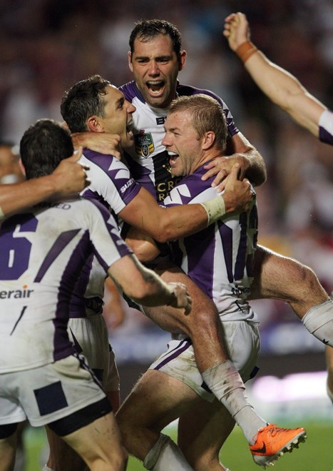 Cameron Smith celebrates with team mates after kicking the winning drop goal in golden point extra time : NRL Rugby League - Round 1. Manly-Warringah Sea Eagles V Melbourne Storm at Brookvale Oval Saturday the 8th of March 2014 . Digital Image by Robb Cox nrlphotos.com