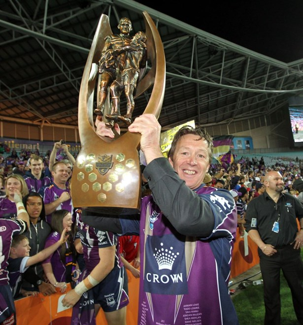 Storm coach Craig Ballamy lifts the trophy: NRL - Grand Final, Melbourne Storm v Canterbury Bulldogs, ANZ Stadium, Sunday 30th September 2012. Photo: Copyright © Renee McKay/Action Photographics