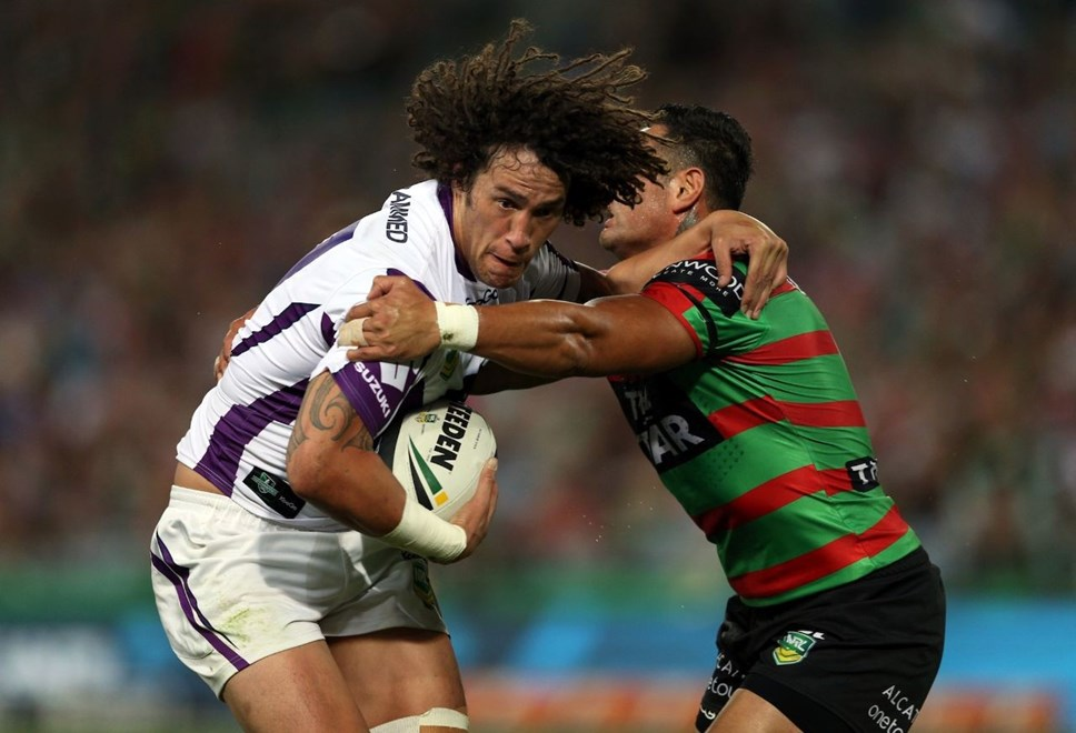 Kevin Proctor is tackled by John Sutton: NRL Round 6, Souths v Storm, ANZ Stadium, Saturday 13th April 2013. Photo: Copyright © Renee McKay/Action Photographics