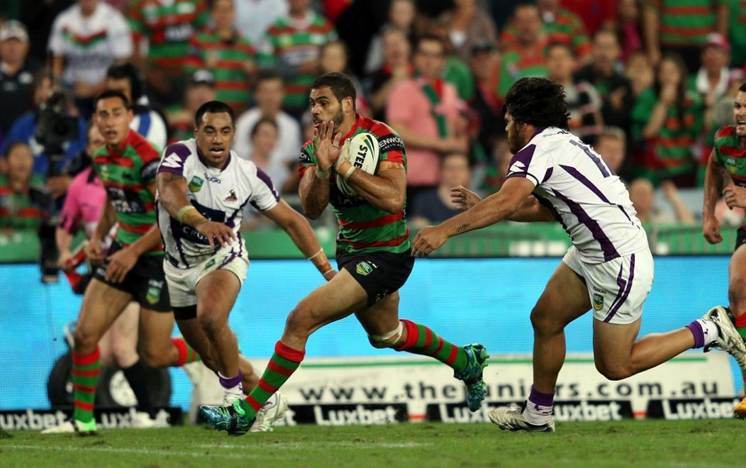 Greg Inglis makes a break: NRL Round 6, Souths v Storm, ANZ Stadium, Saturday 13th April 2013. Photo: Copyright © Renee McKay/Action Photographics