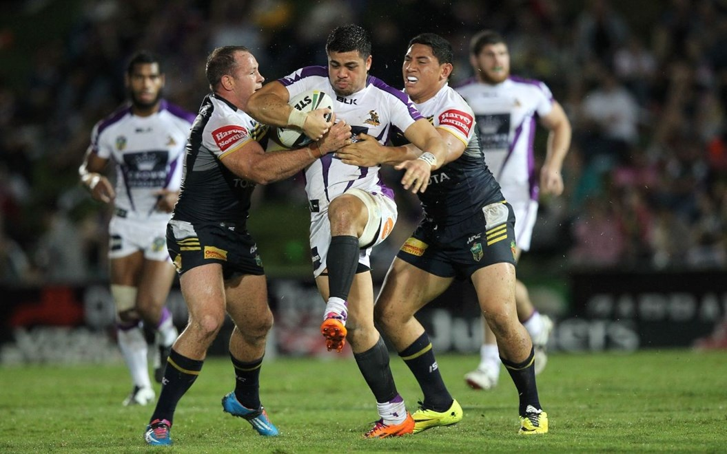 Photo by Colin Whelan copyright © nrlphotos.com :      Young Tonumaipea grabbed by Matt Scott and Jason Taumalolo                         NRL Rugby League, Round 12 North Queensland Cowboys v Melbourne Storm at Townsville, Saturday May 31st  2014.