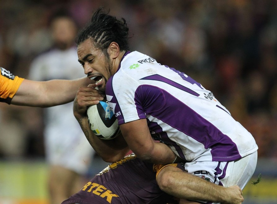 Photo by Colin Whelan copyright © nrlphotos.com :     Mahe Fonua tackled                          NRL Rugby League, Round 20 Brisbane Broncos v Melbourne Storm at Suncorp Stadium, Friday July 25th 2014.