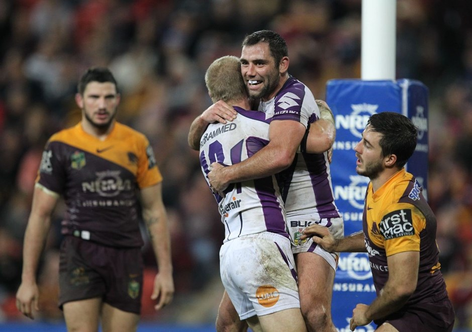 Photo by Colin Whelan copyright © nrlphotos.com :    Cameron Smith jumps on try scorer Cameron Smith                           NRL Rugby League, Round 20 Brisbane Broncos v Melbourne Storm at Suncorp Stadium, Friday July 25th 2014.