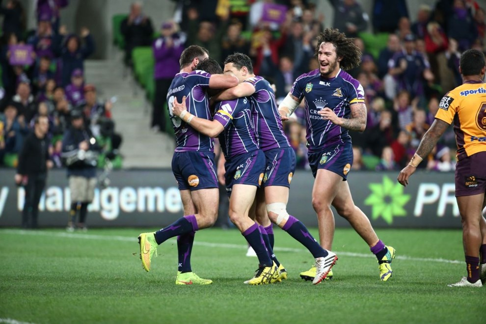 Melbourne Storm celebrate a Cooper Cronk try   Digital Image by Brett Crockford ©nrlphotos.com :	    NRL, Rugby League, Round 26,  Melbourne Storm v  Brisbane Broncos @ AAMI Park, Melbourne, VIC, Friday 5th September, 2014.
