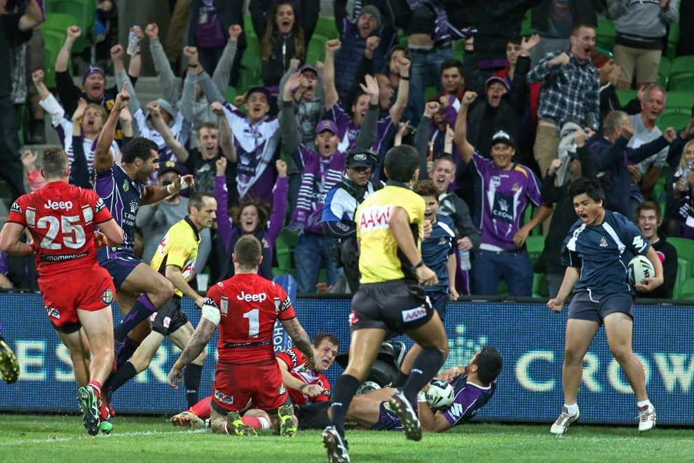 Digital Image by Brett Crockford © nrlphotos.com :	 Melbourne Storm and fans celebrate the late try and win NRL, Rugby League, Round 6 Melbourne Storm v  St George-Illawarra Dragons @ AAMI Park, Melbourne, VIC, Monday April 14th, 2014.