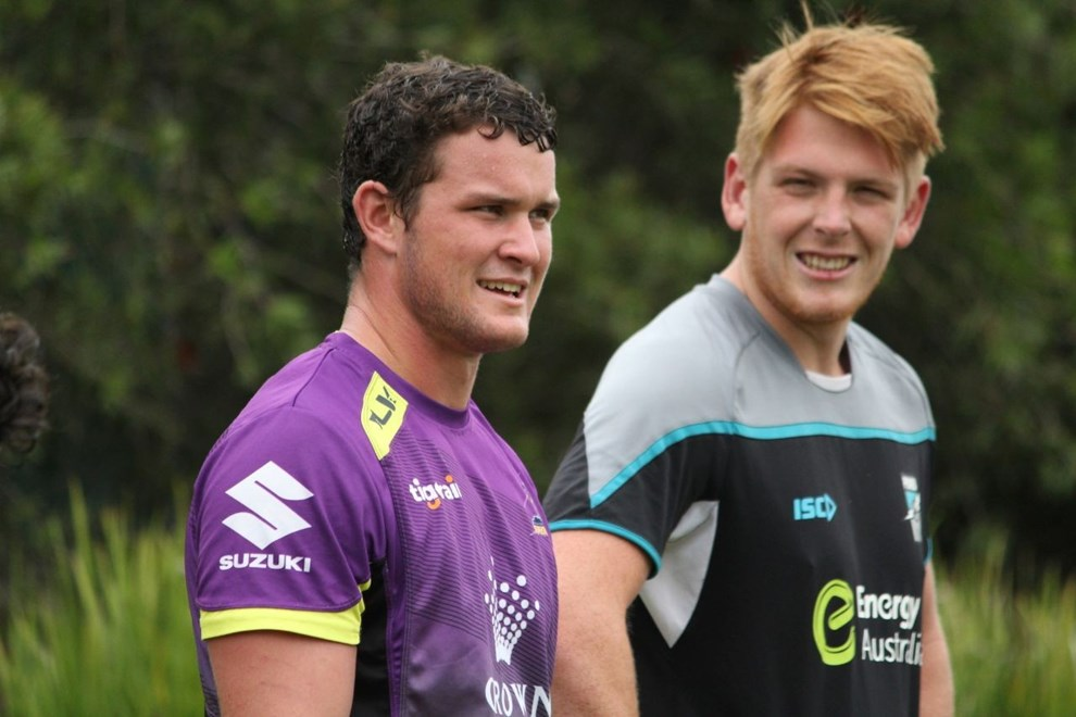 Joe Stimson (Storm) and Mitch Harvey (Power) share a laugh during the joint training session between the two clubs.