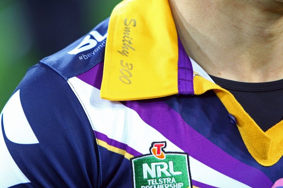 Smithy 300 branding on a Melbourne Storm jersey Digital Image by Ian Knight © nrlphotos.com: NRL, Rugby League, Round 19, Melbourne Storm v Penrith Panthers @ AAMI Park, Melbourne, VIC, Friday July 17th, 2015.