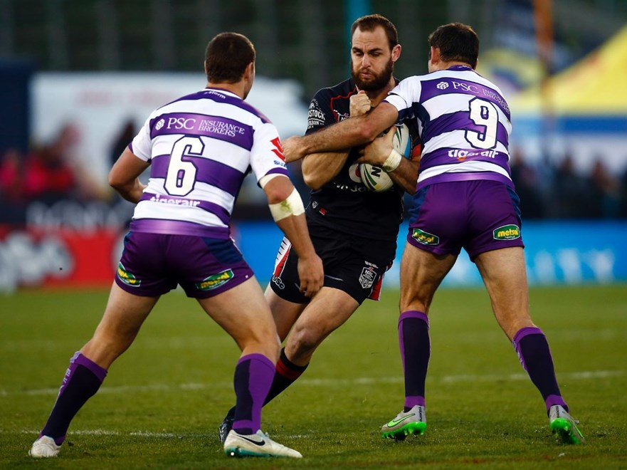 Warriors Simon Mannering runs into the tackle from Storm's Blake Green and Storm's Cameron Smith:           NRL Rugby League, Round 18, NZ Warriors v Melbourne Storm at Mt Smart, Sunday 12th July 2015. Digital image by Shane Wenzlick, copyright nrlphotos.com