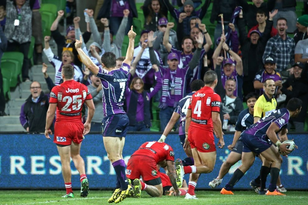Digital Image by Brett Crockford © nrlphotos.com :	 Storm celebrate the win   NRL, Rugby League, Round 6 Melbourne Storm v  St George-Illawarra Dragons @ AAMI Park, Melbourne, VIC, Monday April 14th, 2014.